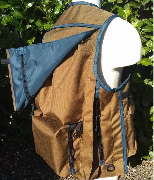 Image of The Side of A Klamath Extreme Cruiser Vest In Coyote Tan With Blue Binding