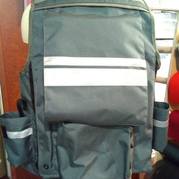 Image of The Back of A Klamath Extreme Cruiser Vest In Smoke With Charcoal Binding & Reflective Tape