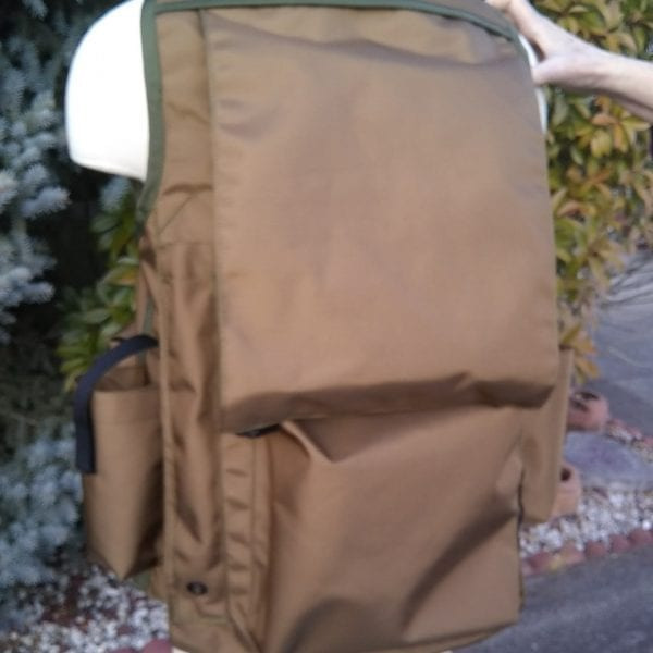 Image of the Back of A Rogue Extreme Cruiser Vest In Coyote with Forest Green Binding