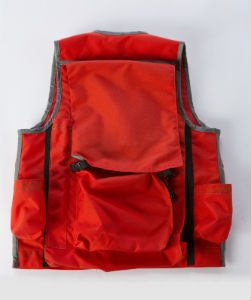 Image of The Back of A Rogue Cruiser Vest In Orange with Grey Binding