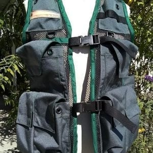 Image of a Woman's Siskiyou Extreme Cruiser Vest In Grey with Forest Green Binding