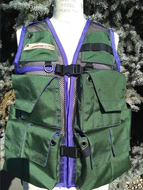 Image of A Woman's Siskiyou Extreme Cruiser Vest In Forest Green With Purple Binding