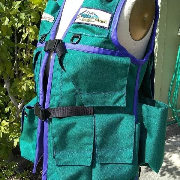 Image of The Side of A Woman's Klamath Extreme Cruiser Vest In Turquoise with Purple Binding