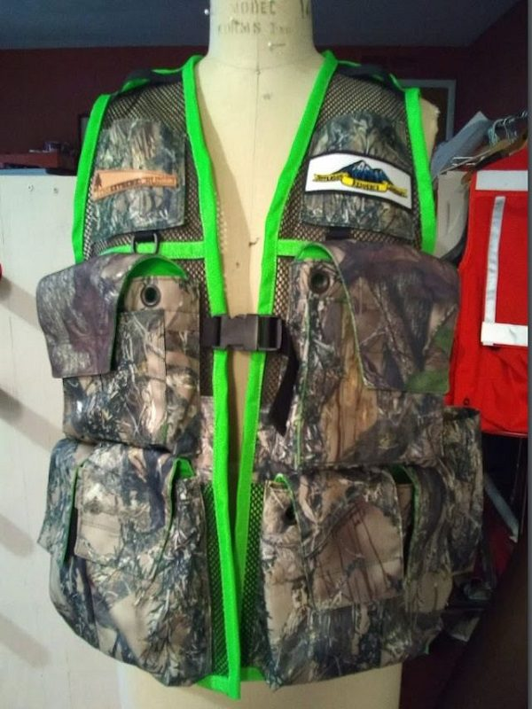 Image of A Woman's Siskiyou Extreme Cruiser Vest In Camo With Fluorescent Green Binding