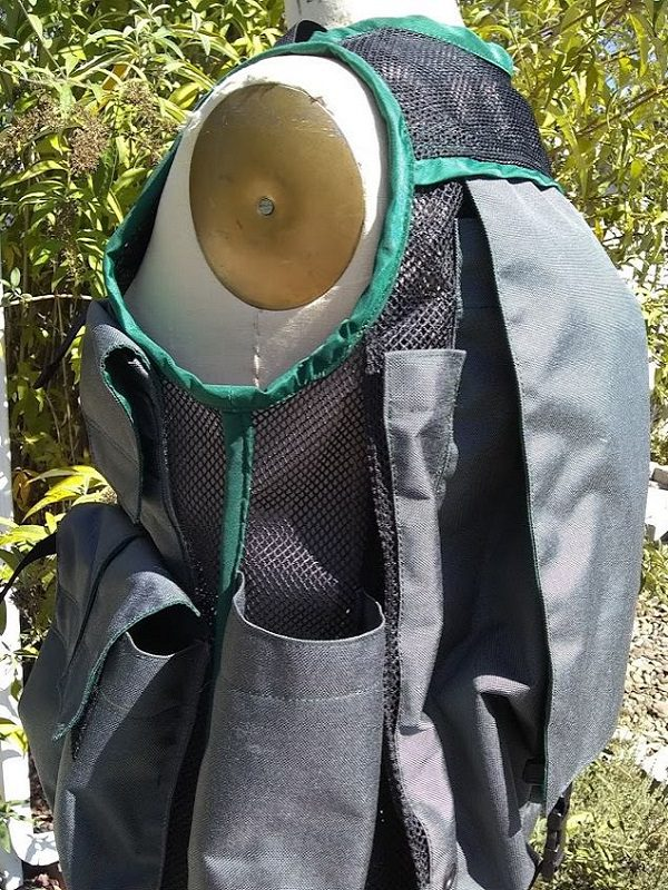 Image of The Side of A Woman's Siskiyou Cruiser Vest in Grey with Forest Green Binding