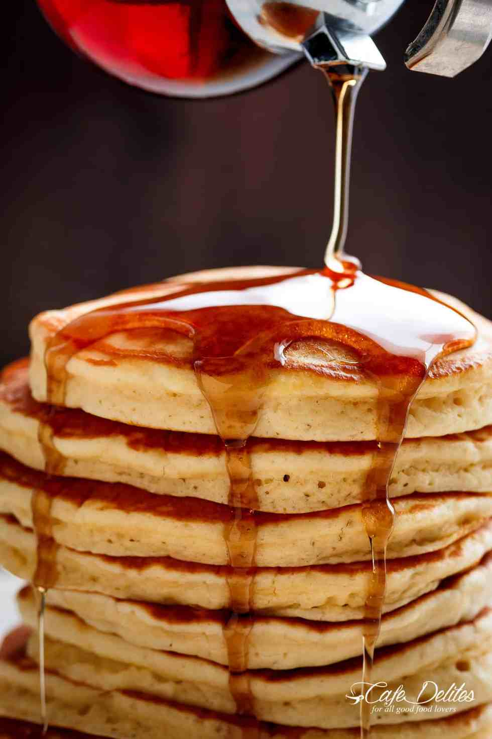 Blood Orange Olive Oil Pancakes Having Syrup Poured on A Stack of Them